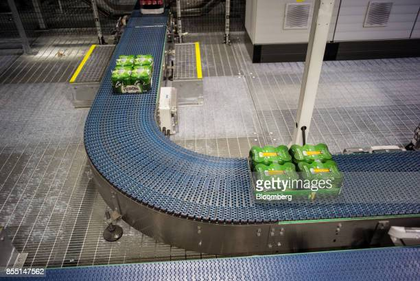 Wrapped trays of Carlsberg beer cans move along a conveyor belt at the end of the production line at the Carlsberg A/S brewery in Fredericia Denmark...