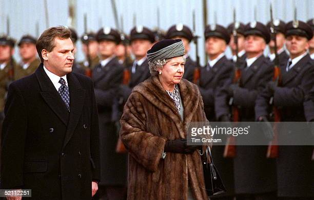 Wrapped Up Warm Against The Cold The Queen Inspects A Guard Of Honour On Her Arrival In Warsaw Poland For Her Historic Visit She Is Accompanied By...
