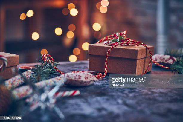 wrapping and decorating christmas presents - giving stock photos and pictures