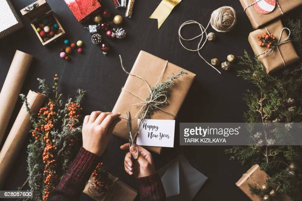 Wrapping New Year gifts, table top flat lay