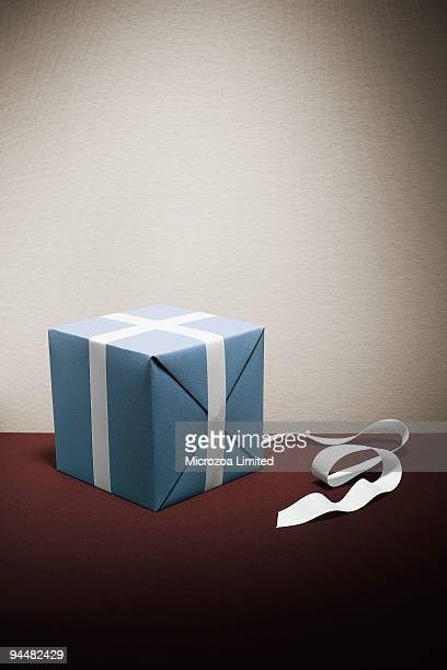 wrapping present - microzoa stock pictures, royalty-free photos & images