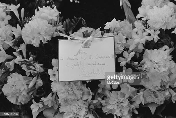 A wreath and note from Queen Elizabeth II on Sir Winston Churchill's grave in Bladon Oxfordshire 31st January 1965 It reads 'From the nation and the...