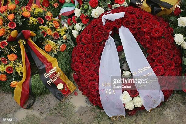A wreath bearing the names of the wife and children of late former German President Johannes Rau lies among other wreaths covering Rau's grave...