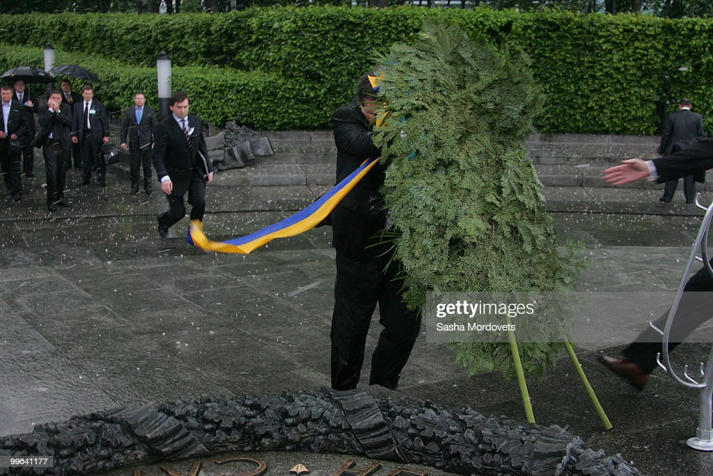 A wreath falls towards the President of Ukraine Viktor Yanukovych during a ceremony to mark the 1932-1933 Soviet famine known as Golodomor on May 17, 2010 in Kiev, Ukraine. Medvedev is in the Ukraine as part of a two-day state visit to improve relations with the former Soviet republic and hammer out a series of agreements with the recently elected Ukrainian President Viktor Yanukovych.