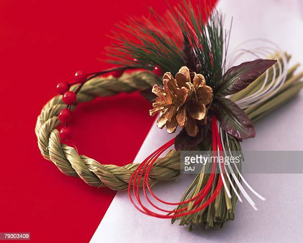 Wreath for New Years Day on white paper, high angle view, red background