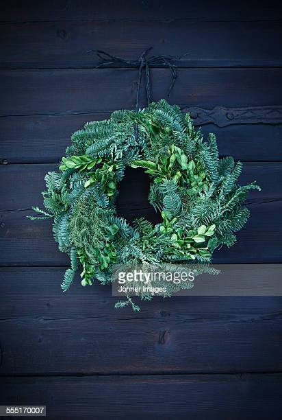 Wreath hanging on wooden wall