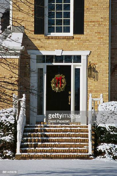 wreath hung on front door - gainesville virginia stock pictures, royalty-free photos & images