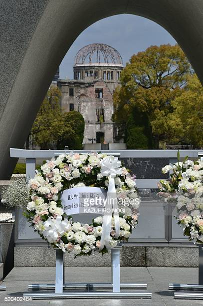 A wreath is offered by US Secretary of State John Kerry at the Memorial Cenotaph for the 1945 atomic bombing victims in the Peace Memorial Park on...
