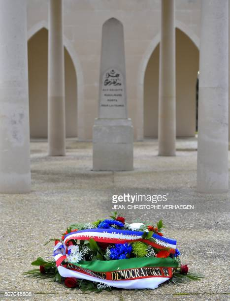 A wreath is pictured in front of the Muslim monument 'La kouba' at the Douaumont National Necropolis and Ossuary in Douaumont eastern France on...