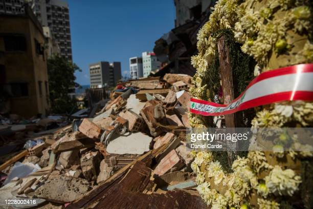 A wreath is placed near the rubble where 4 people were killed by last week's explosion on August 11 2020 in Beirut Lebanon Last week's explosion...