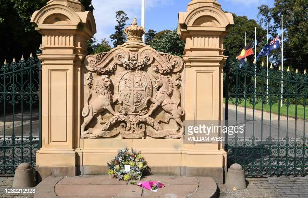 Wreath laid by Victoria's governor Linda Dessau rests outside Government House as flags fly at half mast in Melbourne on April 10, 2021 after the...