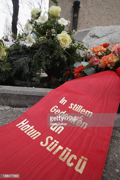 "Wreath left by mourners reads: ""In quiet memorial for Hatun Surucu"" among flowers at the memorial to Hatun Surucu on the 7th anniversary of her..."
