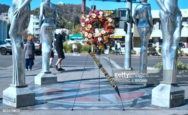 A wreath of flowers arrives courtesy of the Hollywood Chamber of Commerce in tribute to the late Evangelist Pastor Billy Graham in Hollywood...