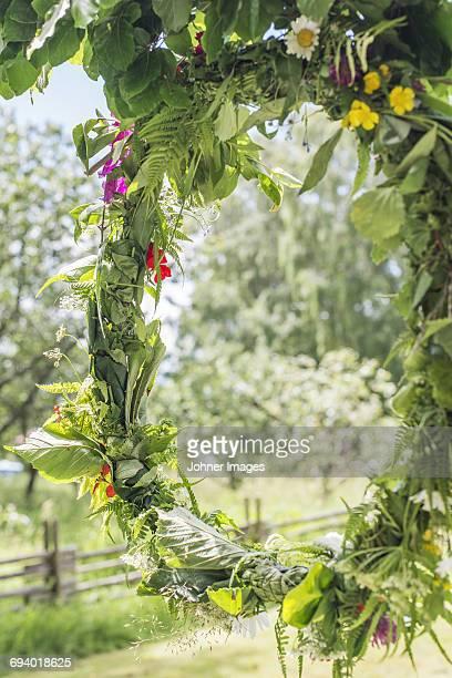 Wreath of flowers hanging on tree