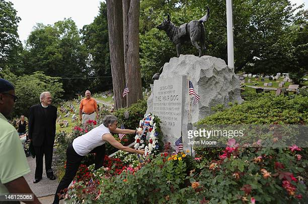 A wreath of flowers is laid at the War Dog Memorial at the annual memorial service for military working dogs at the Hartsdale Pet Cemetery on June 10...