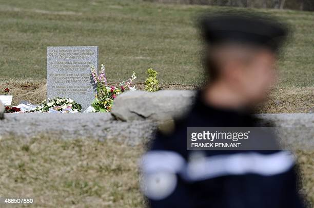 A wreath of flowers is seen after being laid by the French Interior Minister at the stele in memory of the victims of the Germanwings Airbus A320...