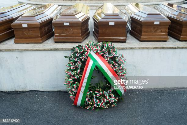 A wreath of flowers is seen next to the coffins of 26 teenage migrant girls found dead in the Mediterranean in early November in the cemetery of...