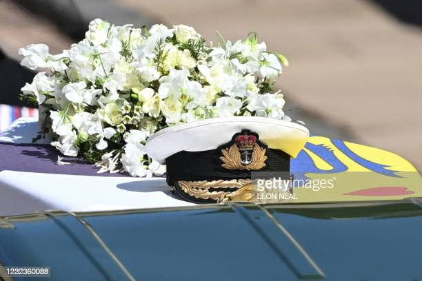 Wreath of flowers lies on the coffin during the ceremonial funeral procession of Britain's Prince Philip, Duke of Edinburgh to St George's Chapel in...