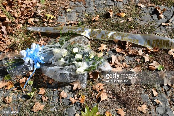 A wreath of flowers with the colors of Lazio's football club and a quote by Holocaust victim Anne Frank lays on the bank of the Tiber river after...