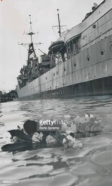 Wreath of remembrance; Memorial wreath floats on the waters of Toronto harbor after service yesterday aboard HMCS Haida to mark the 22nd anniversary...
