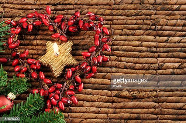 wreath of rose hip with tealight and copyspace