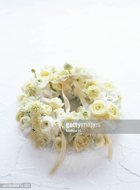 Wreath of rose, scabiosa, hydrangea and ranunculus with ribbon
