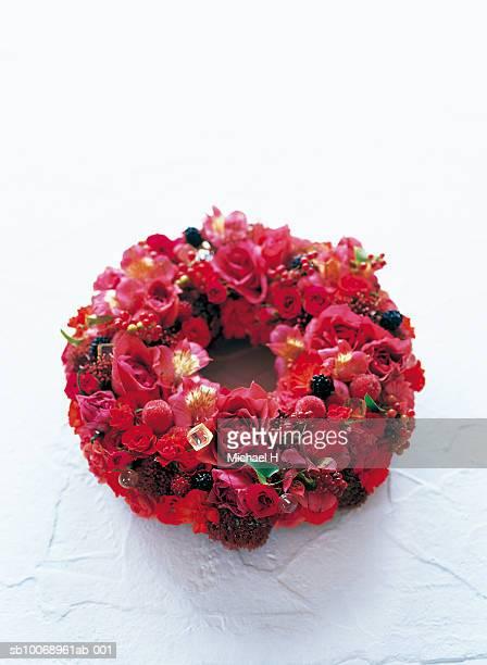 Wreath of rose, spray rose, spray carnation, sedum, italian berry, black berry, red berry and hypericum