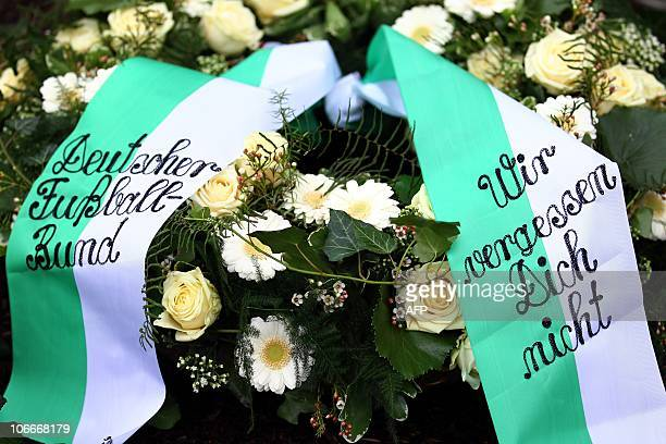 A wreath of the German Football Federation is laid down on the grave of German goalkeeper Robert Enke during a ceremony to commemorate the first...