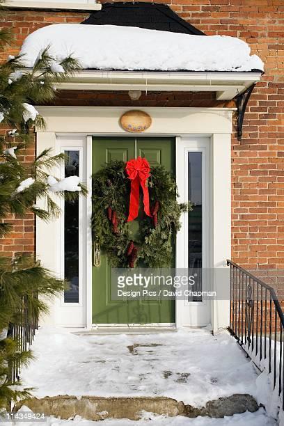 A Wreath On The Front Door In Winter
