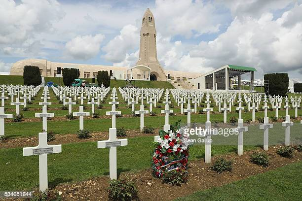 A wreath stands among one of the thousands of crosses marking the graves of French soldiers killed in the Battle of Verdun at the ossuary of...
