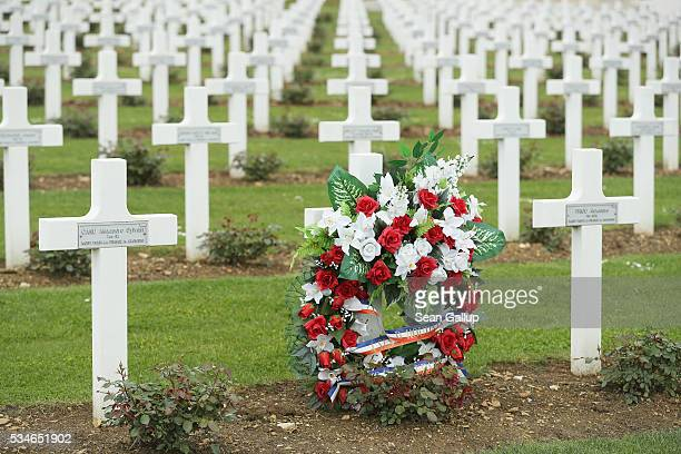 A wreath stands among one of the thousands of crosses marking the graves of French soldiers killed in the World War I Battle of Verdun at the ossuary...