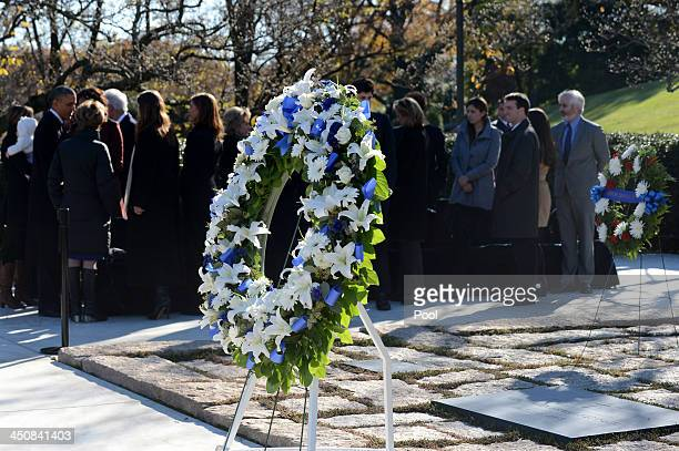 A wreath stands at the grave site of President John F Kennedy as US President Barack Obama talks with members of the Kennedy family after a wreath...