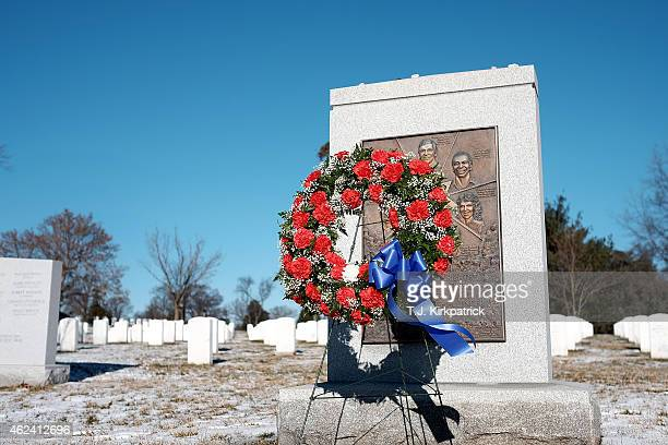 A wreath stands before the space shuttle Challenger memorial on NASA's annual Day of Remembrance at Arlington National Cemetery on January 28 2015 in...