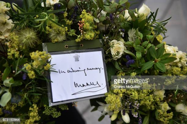 A wreath with a card signed by Prince CharlesPrince of Wale can be seen in the garden of remberance on June 13 2018 in Omagh Northern Ireland This...