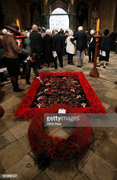 A wreath with a note reading 'In Memory Of The Glorious Dead Elizabeth R and Philip' lies on the Tomb of the Unknown Soldier following a memorial...
