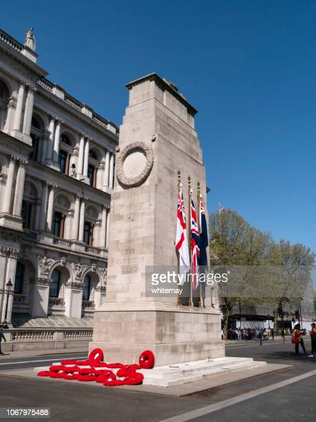 wreaths and flags on the cenotaph in whitehall, london - cenotaph london stock pictures, royalty-free photos & images