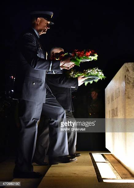 Wreaths are laid by Air Commodore Shaun Clarke of the New Zealand Air Force and veteran Peter Eveille during the dawn service at the Australian War...