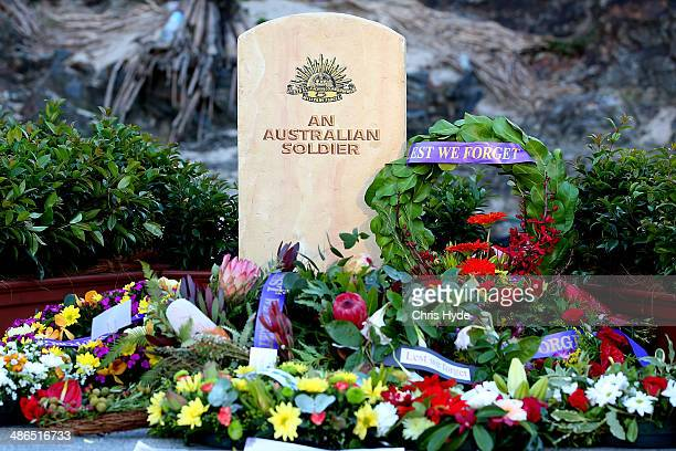 Wreaths are laid during the ANZAC dawn service at Currumbin Surf Life Saving Club on April 25 2014 in Gold Coast Australia Veterans dignitaries and...