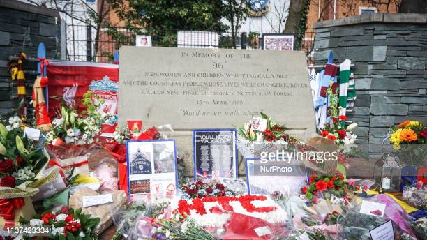 Wreaths are placed during the memorial service in Sheffield , South Yorkshire , 15 April 2019 . Liverpool supporters and members of the public...