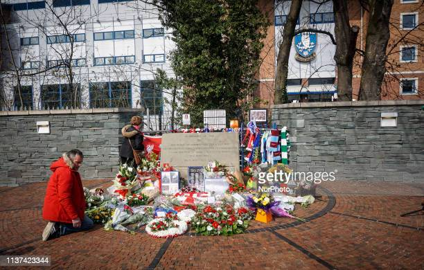 Wreaths are placed during the memorial service in Sheffield South Yorkshire 15 April 2019 Liverpool supporters and members of the public gathered to...