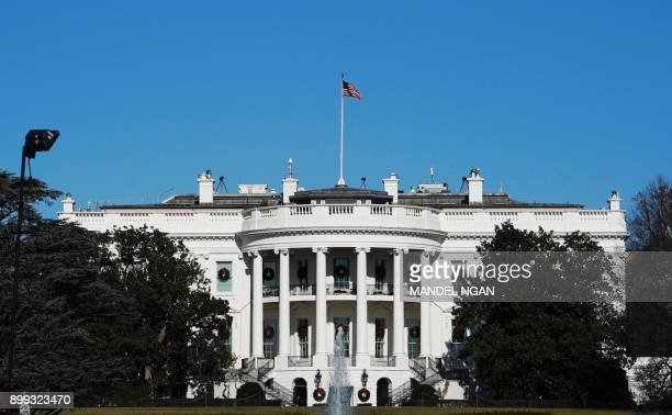 Wreaths are seen on display on the windows of the south side of the White House on December 28 2017 in Washington DC