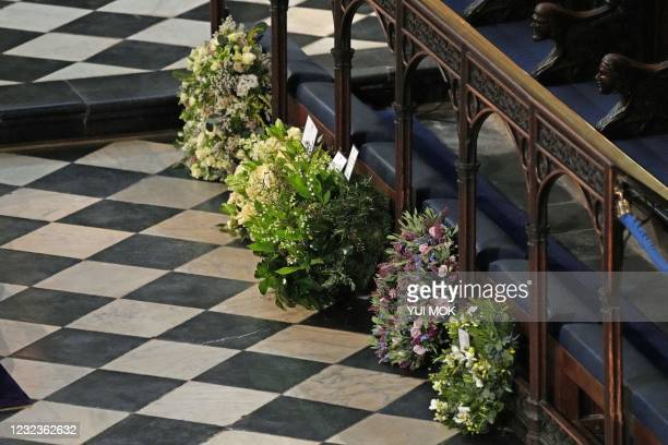 Wreaths from members of the Royal family during the funeral service of Britain's Prince Philip, Duke of Edinburgh at St George's Chapel at Windsor...