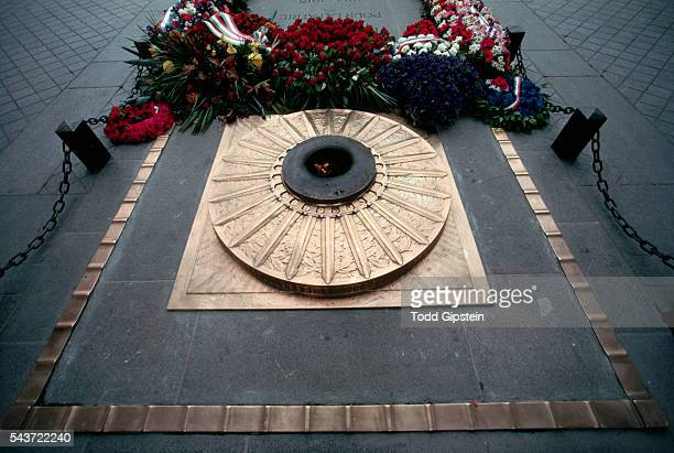 Wreaths of red roses and an eternal flame decorate the Tomb of the Unknown Soldier beneath the L'Arc de Triomphe