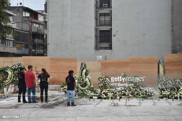 Wreaths were placed to honor the the dead on the site where a building was flattened by a strong 71magnitude quake four days ago in Mexico City on...