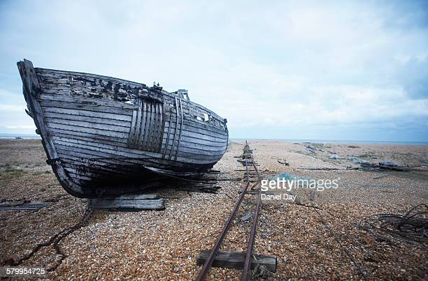 Wreck of a fishing boat and old rail track