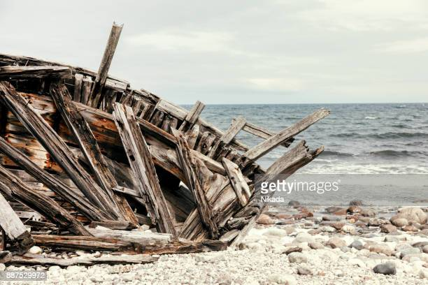 wreck of an old wooden ship - pirate ship stock photos and pictures