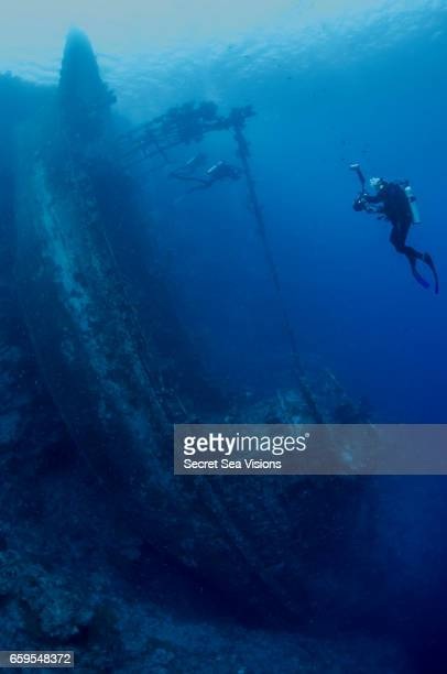 Wreck of fishing trawler and photographer