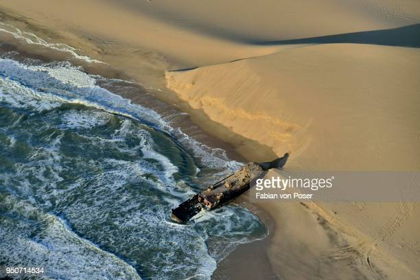 wreck of the shaunee, shipwrecked in 1976, namibian coast near conception bay, south of sandwich harbour, aerial view, namib-naukluft national park, namibia - namib naukluft national park stock pictures, royalty-free photos & images