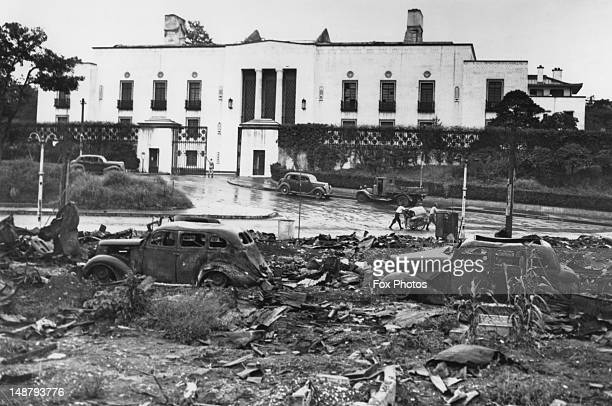 Wreckage and burned-out cars outside the former American embassy in Tokyo after US air-raids on the city, September 1945.