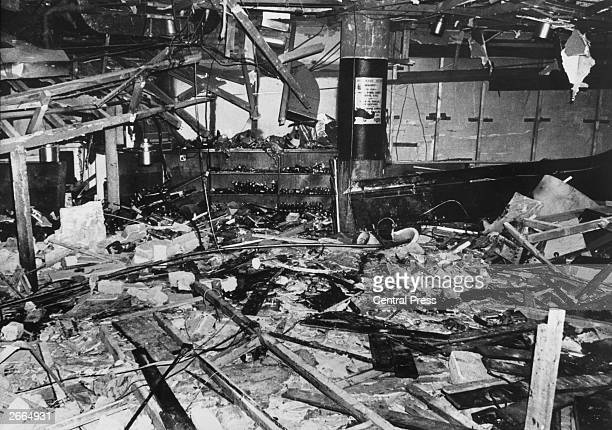 Wreckage and debris litter thebarely recognisable interior of the 'Mulberry Bush' public house in Birmingham after it was bombed by the Provisional...